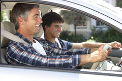 Father On Car Journey With Teenage Son Stock Images
