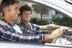 Father On Car Journey With Teenage Son Stock Image
