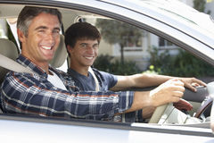Father On Car Journey With Teenage Son Royalty Free Stock Photography