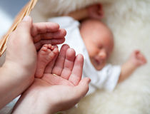 Father carefully keep newborn baby's foot Royalty Free Stock Photography