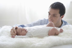 Father Caressing Newborn Baby's Head Royalty Free Stock Photo