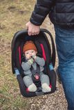 Father carrying baby in safety seat Royalty Free Stock Photo