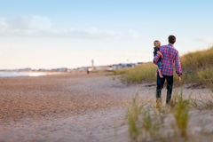Father carrying child  Royalty Free Stock Images