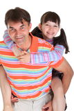 Father carrying daughter. Father carrying his daughter on his back, both smiling, isolated on a white background Royalty Free Stock Image