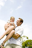 father carrying daughter in his arms Royalty Free Stock Image