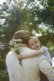 Father Carrying Daughter Outdoors Stock Images