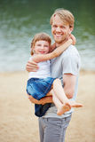Father carrying daughter in summer vacation Stock Image