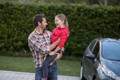 Father carrying his daughter in his arms Royalty Free Stock Photo