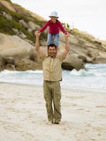 A father carrying with his daughter on his shoulders Royalty Free Stock Photos