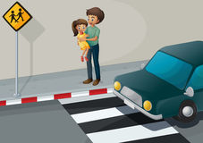 A father carrying his daughter at the pedestrian lane Royalty Free Stock Photos