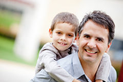 Father carrying his son Stock Image
