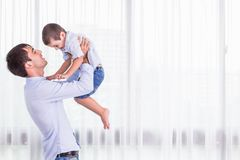 Father carrying his son. Good health baby smiling on shoulder of Royalty Free Stock Photos