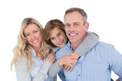 Father carrying his son on his back with his wife next to him Royalty Free Stock Image