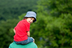 Father, carrying his son on his neck, child looking at camera royalty free stock photos
