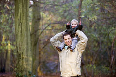 A father carrying his son on his shoulders stock images
