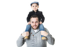 Father carrying his son on shoulders - isolated over a white background. A Father carrying his son on shoulders - isolated over a white background Royalty Free Stock Image