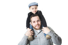 Father carrying his son on shoulders - isolated over a white background. A Father carrying his son on shoulders - isolated over a white background Stock Images