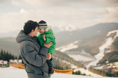 Father carrying his son to winter landscapes Royalty Free Stock Photo