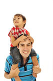 Father carrying son on his shoulders. Young father carrying his son on his shoulders, isolated on white background Stock Photos