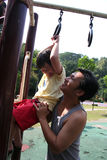Father carrying son. At the playground in the park Royalty Free Stock Photography