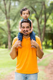 Father carrying son Royalty Free Stock Photos