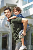 Father carrying son on his back Royalty Free Stock Images