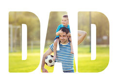 Father carrying son on his shoulders. Fathers day concept. Royalty Free Stock Image