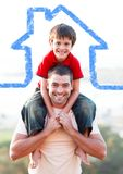 Father carrying son on his shoulders overlaid with house shape Stock Images