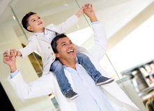 Father carrying his son Royalty Free Stock Photos