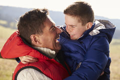 Father carrying son outdoors in countryside, close up Royalty Free Stock Photo
