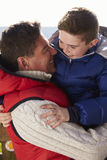 Father carrying son outdoors, vertical Stock Photography