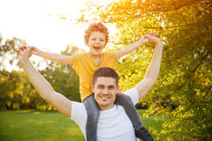 Father carrying son in park Royalty Free Stock Photography