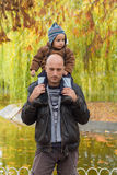 Father carrying son piggyback Royalty Free Stock Photography