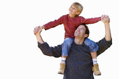 Father carrying son on shoulders, cut out Stock Images
