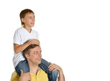 Father carrying son on shoulders. Father carrying his son on shoulders  over a white background Stock Photos