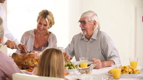 Father carving the turkey at the head of the table Royalty Free Stock Photos