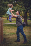 Father catching daughter Royalty Free Stock Photo