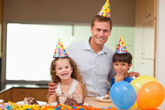 Father celebrating birthday with his kids Stock Images