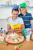 Father celebrating his birthday with his son Stock Images