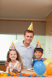 Father celebrating with his kids Royalty Free Stock Image