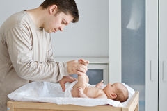 Father changing diaper Royalty Free Stock Photos
