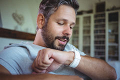 Father checking time on smart watch Stock Photography