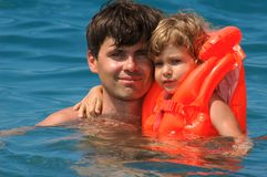 Father with child. In water pool Stock Images