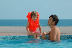 Father with child. In water pool Royalty Free Stock Images