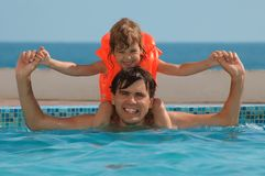 Father with child. In water pool Stock Photography