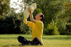 Father and child. On green grass Royalty Free Stock Photo