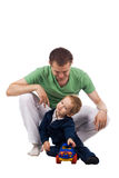Father with child. Isolated play toy car Royalty Free Stock Image