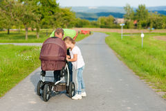 Father with child and baby buggy Royalty Free Stock Images