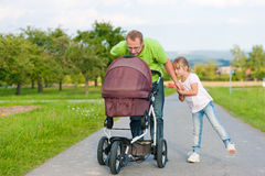 Father with child and baby buggy Stock Image
