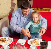 Father and child in cafe Royalty Free Stock Images